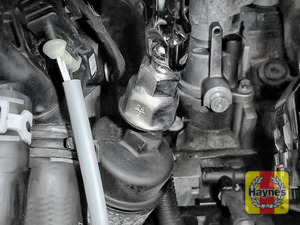 Illustration of step: Using a 24mm filter wrench socket, fit the tool securely onto the oil filter housing - step 6