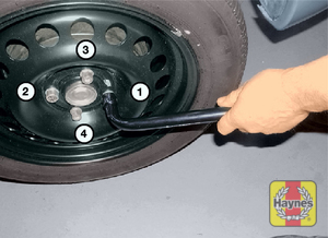 Illustration of step:  Lower the vehicle to the ground, then finally tighten the wheel bolts in a diagonal sequence - step 8
