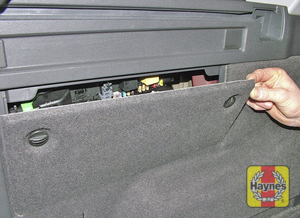 Illustration of step: Undo the fasteners and remove the luggage compartment left-hand side panel to access the main fusebox - step 1