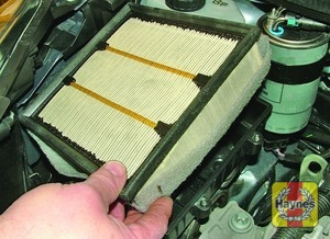 Illustration of step:  Lift out the air cleaner filter element  - step 12