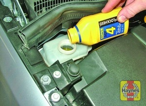 Illustration of step:  Carefully add fluid, taking care not to spill it onto the surrounding components -  Safety first! - step 28