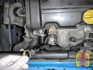 Illustration of step: Remove the dipstick and place the vacuum extractor pipe down dipstick tube - step 1