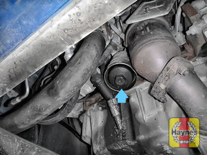Illustration of step: General location of oil filter is accessed from underneath the car - step 1