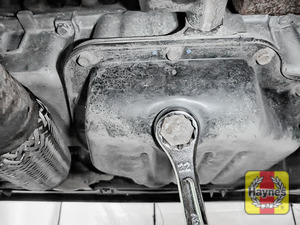 Illustration of step: Using a 22mm spanner or socket, carefully remove the sump plug and fully drain the oil - step 3