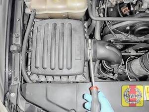 Illustration of step: First, undo circular clip on the air intake - use a 7mm socket or a screwdriver - step 2
