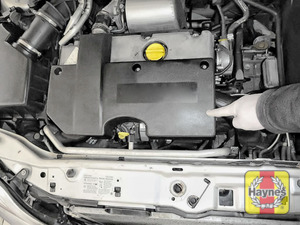 Illustration of step: The location of oil filter is underneath the engine cover - step 1