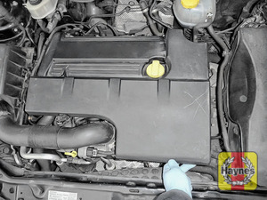 Illustration of step: The oil filter is under the engine cover - step 1