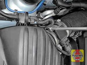 Illustration of step: First, undo the circular clip on the air intake - use a 7mm socket - step 2