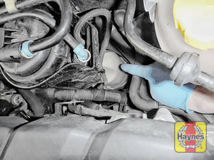 Illustration of step: The power steering fluid reservoir is located down here - step 1