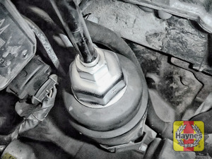 Illustration of step: Using a 36mm filter wrench socket, fit the tool securely onto the oil filter housing - step 5
