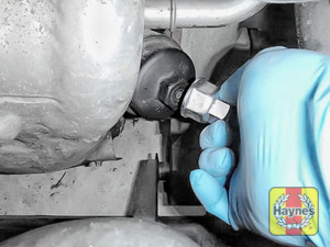 Illustration of step: Using a 24mm filter wrench socket, fit the tool securely onto the oil filter housing - step 3