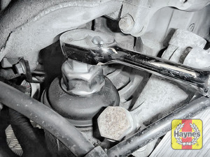 Illustration of step: Using a 32mm filter wrench socket, fit the tool securely onto the oil filter housing - step 2
