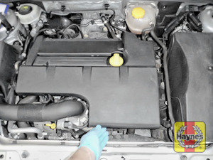 Illustration of step: The location of oil filter cartridge is underneath the engine cover - step 1