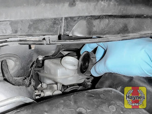 Illustration of step: If the level needs topping up - WEARING GLOVES - carefully open the cap, have a paper towel ready to catch any drips as brake fluid is corrosive - step 3