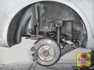 Illustration of step: As with the fronts, check for wear in the wheel hub bearings by grasping the wheel and trying to rock it - step 8