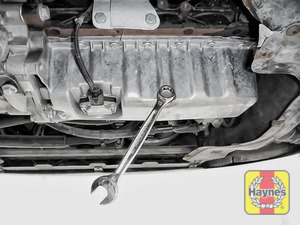 Illustration of step: Using a 19mm spanner or socket, carefully remove the sump plug and fully drain the oil - step 6