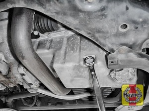 Illustration of step: Using a 19mm spanner or socket, carefully remove the sump plug and fully drain the oil - step 4