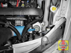 Illustration of step: The power steering fluid reservoir is located by the car battery - step 1