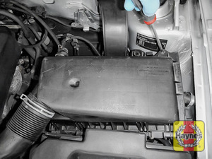 Illustration of step: Now undo the 4 Phillips retaining fixings located on the air filter body - step 3