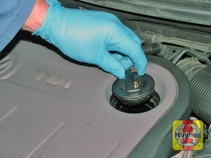 Illustration of step:  Oil is added through the filler cap aperture, unscrew the cap - Car care - step 13