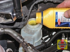 Illustration of step:  Carefully add fluid, avoiding spilling it on the surrounding paintwork - Safety first! - step 29