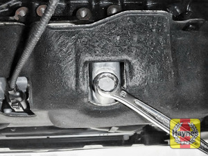 Illustration of step: With a oil catchment tray in position, Using a 19mm spanner or socket, carefully remove the sump plug and fully drain the oil - step 7