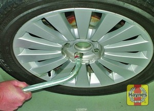 Illustration of step:  Fit the spare wheel, then tighten the bolts moderately with the wheel brace - step 8