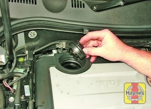 Illustration of step:  Oil is added through the filler cap on top of the engine - Car care - step 12