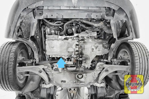 Illustration of step: The sump plug is located on the base of the engine; it is accessed underneath the car - step 1