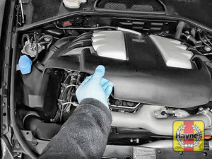 Illustration of step: Now, using both hands, release the engine cover - step 3