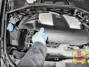 Illustration of step: Release the engine cover to access the oil filter cartridge  - step 1