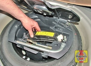 Illustration of step:  The spare wheel and tools are stored in the luggage compartment - step 2