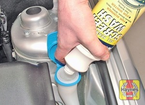 Illustration of step:  When topping-up the reservoir, a screenwash additive should be added in the quantities recommended on the bottle - Washer fluid level - step 35