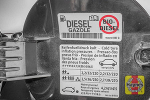 Illustration of step: Look for a sticker showing your vehicles tyre pressures, usually located on the back of the fuel filler cap - step 3