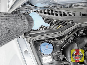 Illustration of step: Locate the brake fluid reservoir - it is under this grille - step 1