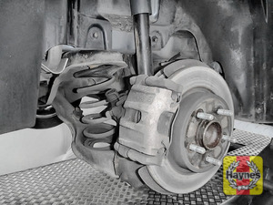 Illustration of step: Take a good look around brake system and the suspension arm, checking for any leaks - step 12