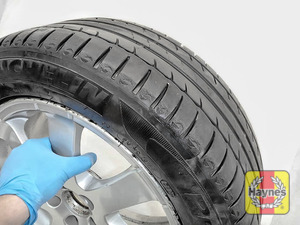 Illustration of step: Before refitting the tyres, take a look at the tyre tread; there is a UK legal requirement to have a minimum of 1 - step 14
