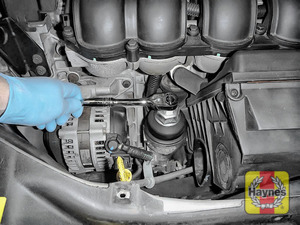 Illustration of step: Loosen the oil filter housing by unscrewing anti-clockwise - step 7
