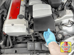 Illustration of step: Remove this cover to access the steering fluid reservoir - step 2