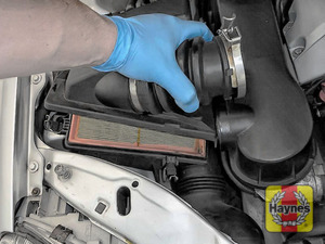 Illustration of step: Carefully separate and lift the air filter top assembly - step 4