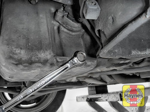 Illustration of step: Using a 13mm spanner or socket, carefully remove the sump plug and fully drain the oil - step 6