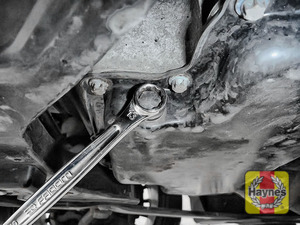 Illustration of step: Using a 13mm spanner or socket, carefully remove the sump plug and fully drain the oil - step 7