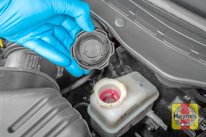 Illustration of step: If the level needs topping up - WEARING GLOVES - carefully open the cap, have a paper towel ready to catch any drips as brake fluid is corrosive, Now securely replace and tighten the cap - step 4