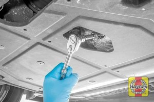 Illustration of step: With an oil catchment tray in position, use a 17mm spanner or socket to carefully remove the sump plug and fully drain the oil - step 4