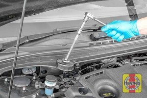 Illustration of step: Using a specific oil filter wrench socket for this Hyundai, fitting the tool securely onto the oil filter housing - step 2