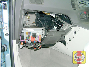 Illustration of step: Unclip the panel from the passenger's side of the fascia to access the main fusebox - step 1