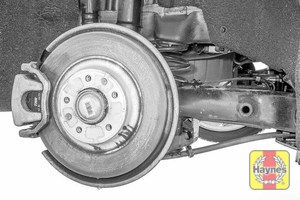 Illustration of step: Take a good look around the brake system and the suspension arm, check for any leaks - step 14