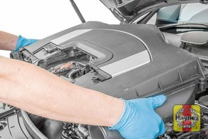Illustration of step: Carefully lift the combined engine cover and air filter housing away from the engine  - step 8