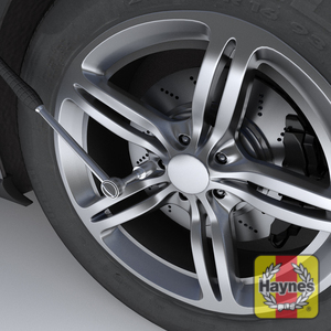 Illustration of step: ALWAYS loosen the wheel nuts BEFORE jacking the car ! Quarter to half turn, anti -clockwise is plenty to loosen the wheel nuts - step 1