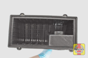 Illustration of step: View of the air filter cover - clean off any dust or debris - step 9